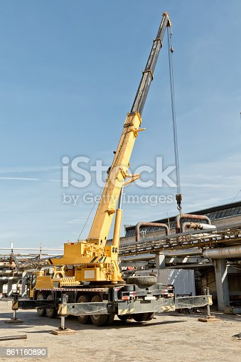 Works on installation of pipelines in oil refinery plant with auto crane heavy-duty