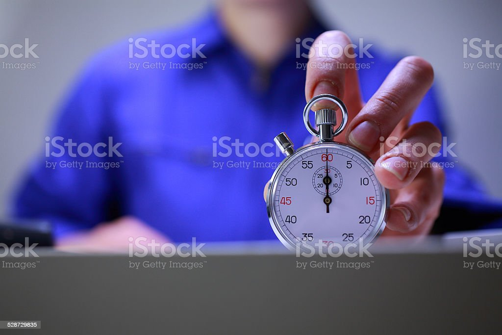 Workshop director holding a stopwatch stock photo