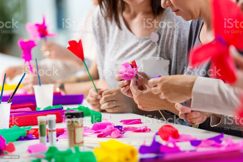 Workshop for women Group of women attending a workshop, making paper flowers. Adult Stock Photo