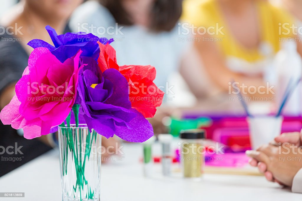 Workshop for women Group of women attending a workshop, making paper flowers. Close up of paper flower. Adult Stock Photo