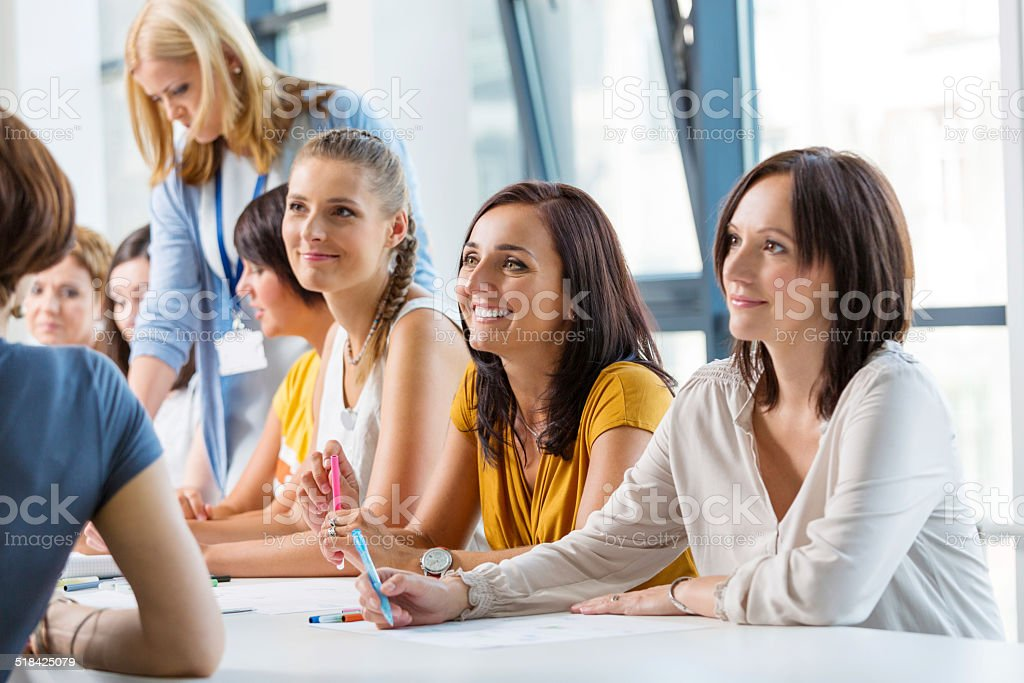 Workshop for women Group of women attending a training, working together and discussing. 30-39 Years Stock Photo