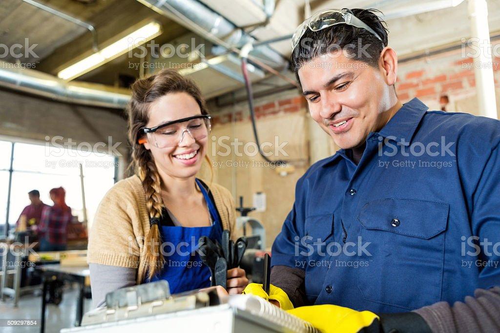Workshop inspector talks with workshop manager stock photo