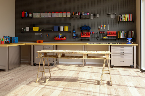 Workshop Interior With Tools, Working Equipments And Wooden Working Table.