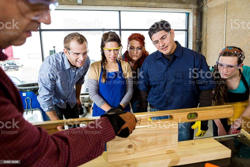 Workshop manager uses leveler tool in workshop stock photo