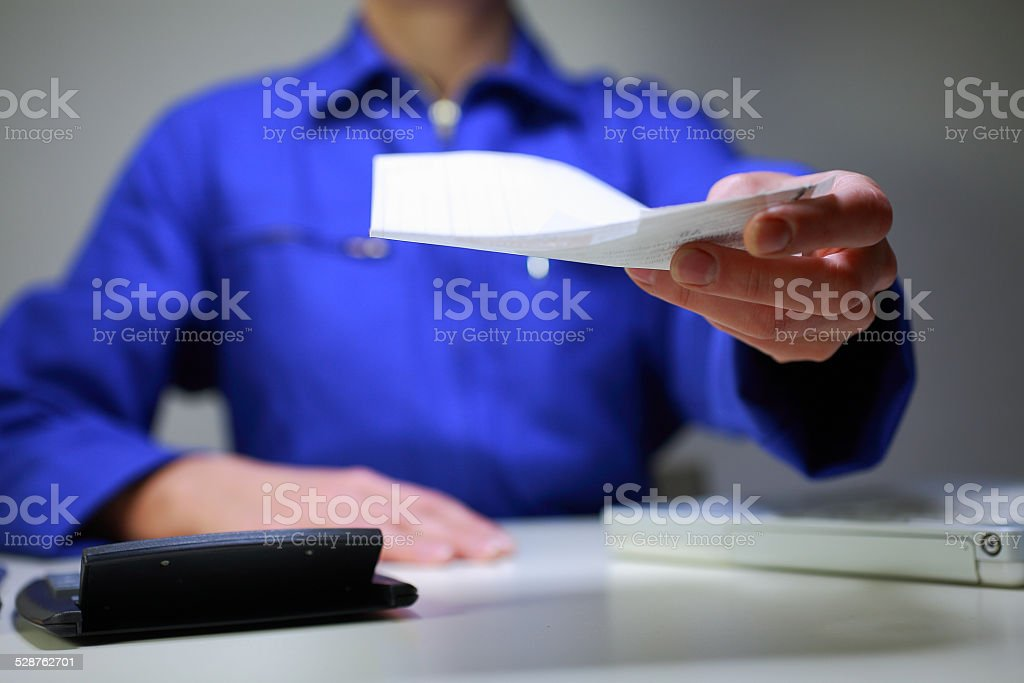 workshop manager with an invoice to a customer stock photo