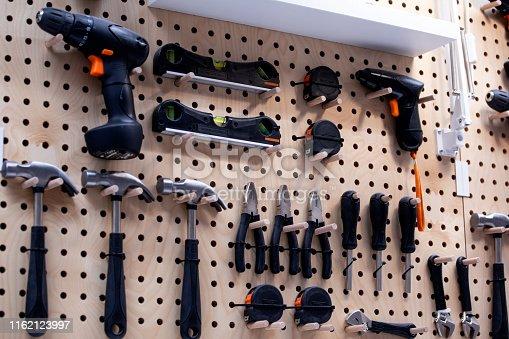 Workshop scene. Tools hanging on wall in workshop, Tool shelf