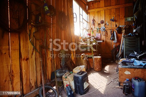 1155772265 istock photo Workshop, shed, garage or storage room with tools for repair, chores, spare parts from various equipment. 1179990604