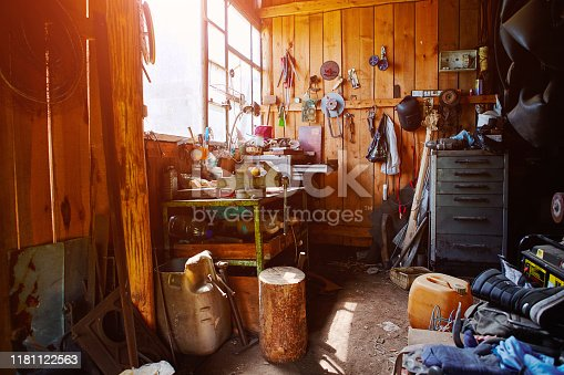 1155772265 istock photo Workshop, shed, garage or storage room with tools for repair, chores, spare parts from various equipment. 1181122563