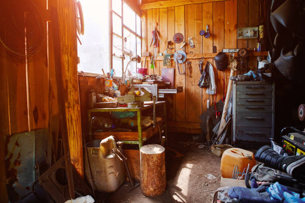 Workshop, shed, garage or storage room with tools for repair, chores, spare parts from various equipment. stock photo