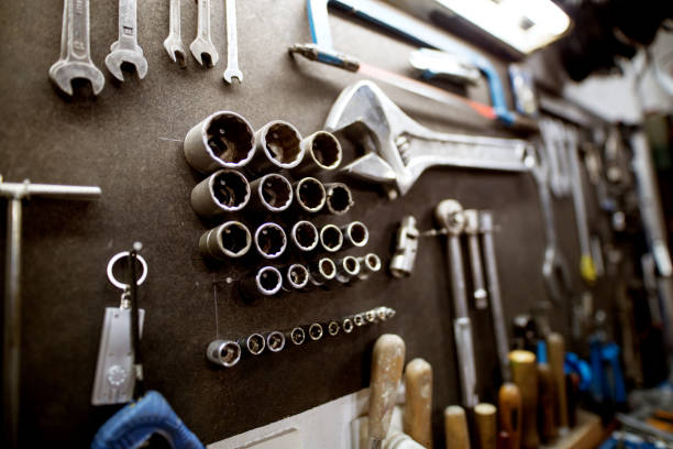 Workshop tool holder with a wrench and set of wrench sockets. stock photo
