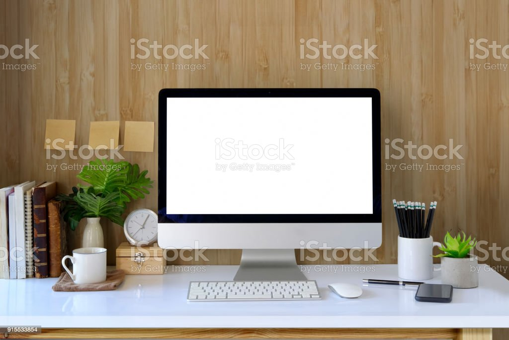 Workspace And Blank Screen Desktop Computer.Mockup Desktop Computer, Coffee  Mug, Plant And