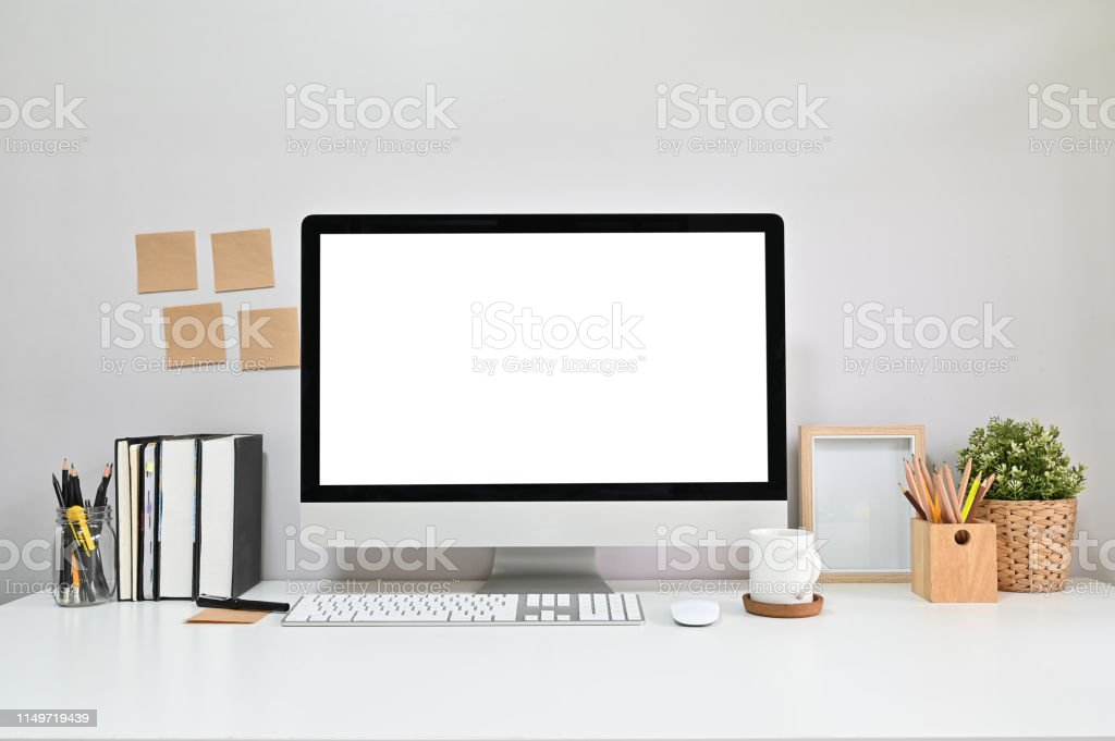 Workspace Computer with books, coffee, photo frame, sticky note on...