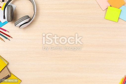 Wooden desk workplace top view nobody copy space
