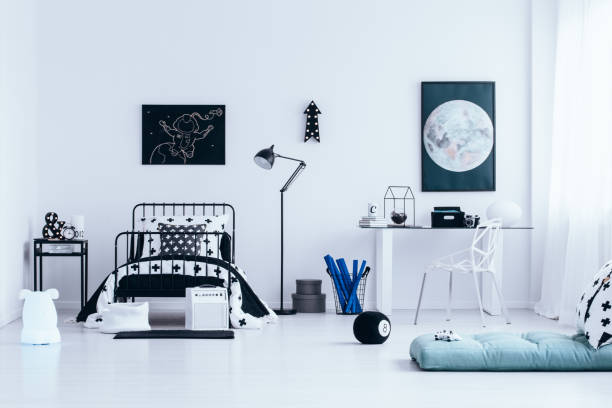 Workspace in bright bedroom interior stock photo