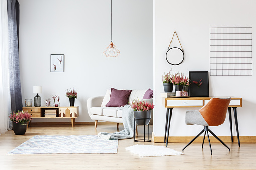 istock Workspace in bright living room 886697628