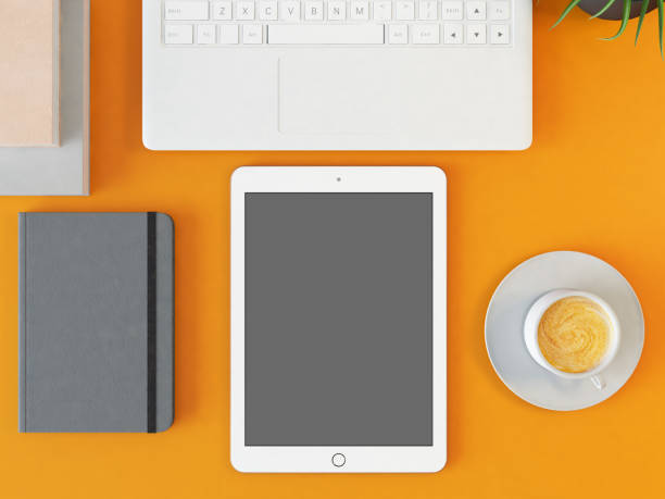 Workspace in Office with Tablet and Laptop. Above View stock photo