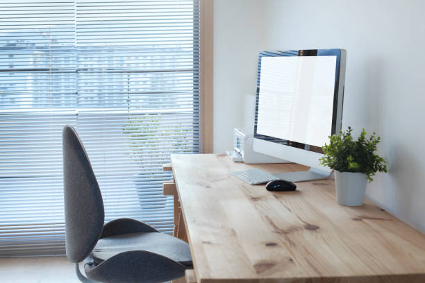 workspace interior with computer on wooden table and office chair stock photo