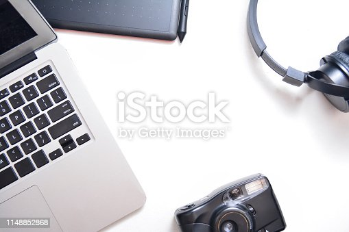 istock Workspace, laptop, headphones, camera and tablet on a white background. Flat lay with 1148852868