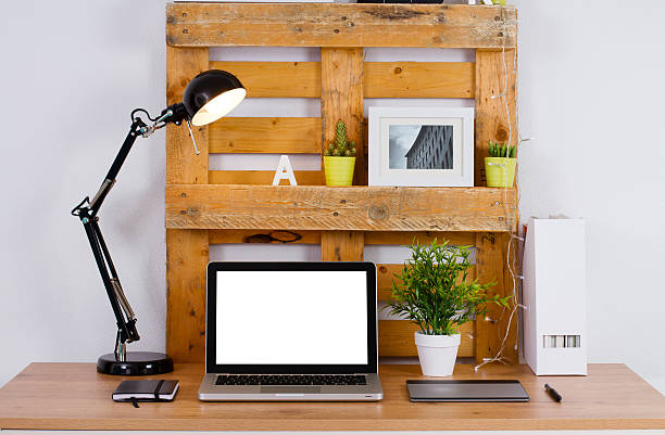 DIY workspace make with pallet. Computer blank on the desk stock photo