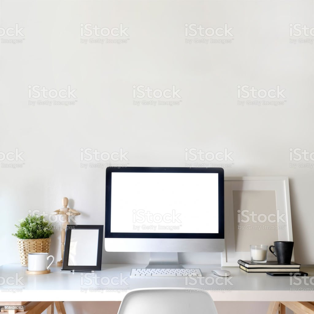 Workspace mockup poster with white screen desktop computer and stuff on white wooden table. stock photo