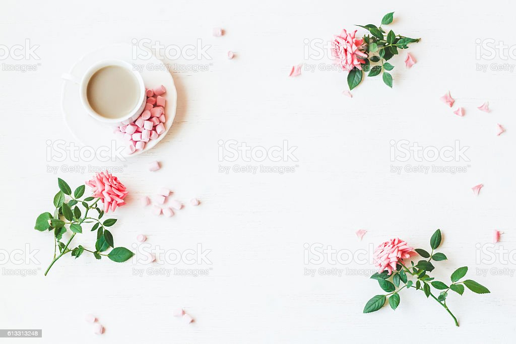 Workspace. Rose flowers. Flat lay, top view