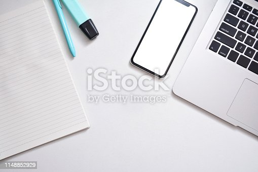 615494694 istock photo Workspace, Smartphone, headphones and laptop on a white background. Flat lay with 1148852929