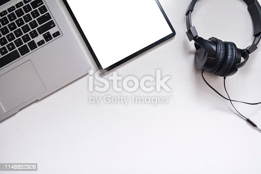 istock Workspace, Tablet, headphones and laptop on a white background 1148852926