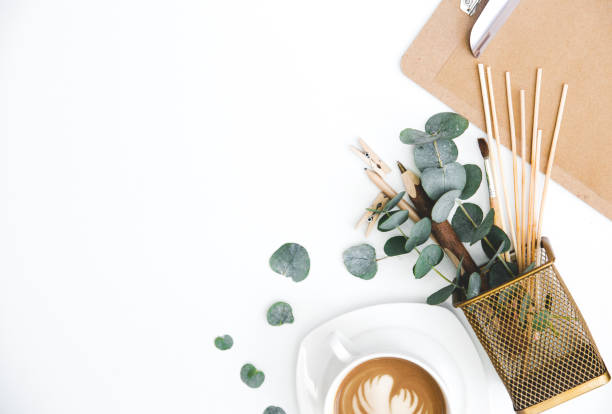Workspace with clipboard and cup of coffee. Flat lay, top view. Femine desk. Blogger or freelance concept stock photo