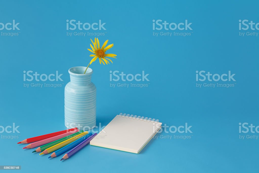 Workspace with colored pencils and notebook royalty-free stock photo