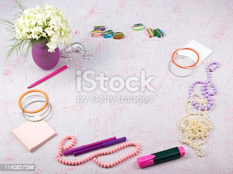 604021340 istock photo Workspace with computer, bouquet Hydrangeas, clipboard. Women's fashion accessories isolated on pink background. Flat lay. Top view office desk. 1140827398