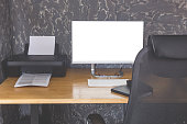 Workspace with computer display for mockup on table
