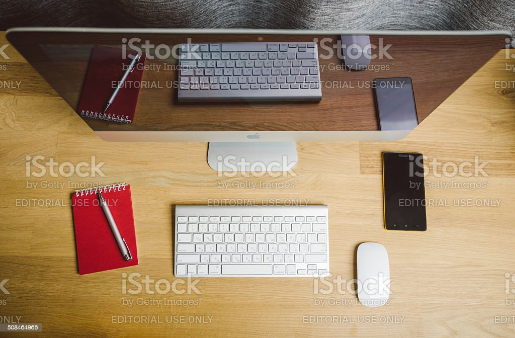 workspace with computer on home or studio, Apple iMac desktop stock photo