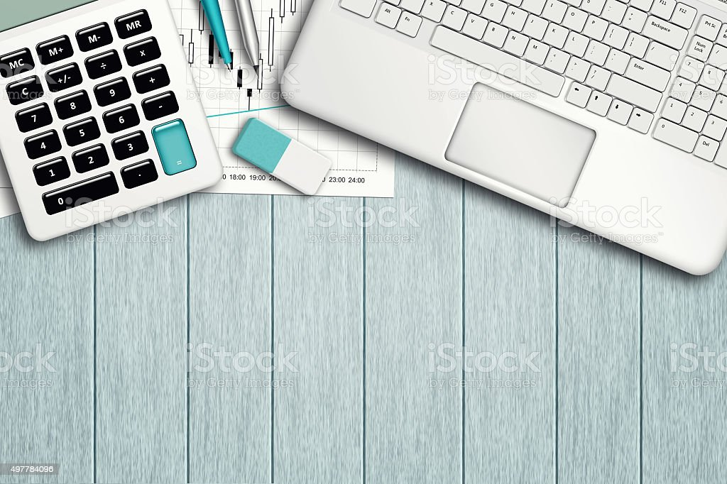 workspace with graph, computer, graph, calculator and stationery stock photo