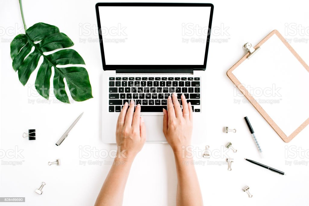 Workspace with hands typing on laptop stock photo