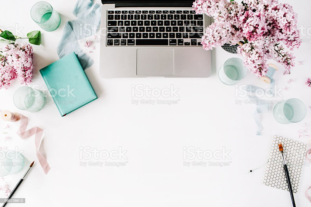 Workspace with laptop and lilac - foto de acervo
