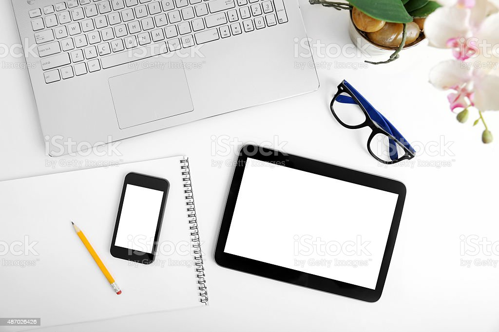 workspace with laptop, blank digital tablet and smartphone stock photo