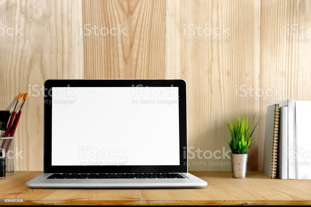 Workspace with laptop computer, office supplies flower plant at home or studio. Mock up desk space. stock photo