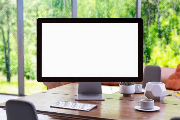 Workspace with Mock up PC Monitor and Coffee stock photo