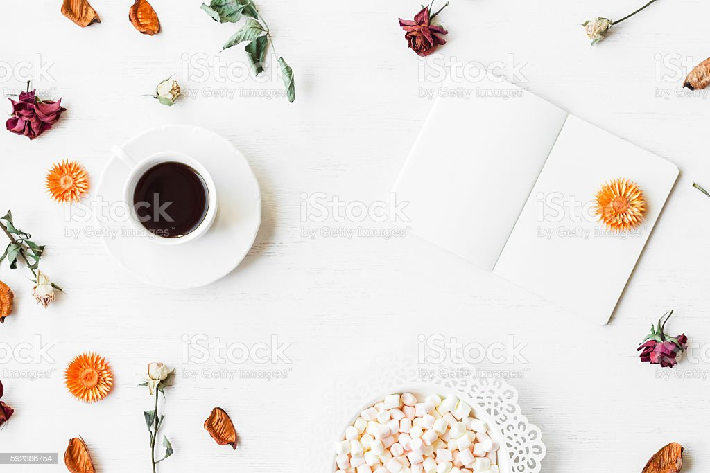Workspace with notebook, cup of coffee and autumn leaves stock photo