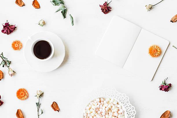 workspace with notebook, cup of coffee and autumn leaves - folha de caderno imagens e fotografias de stock