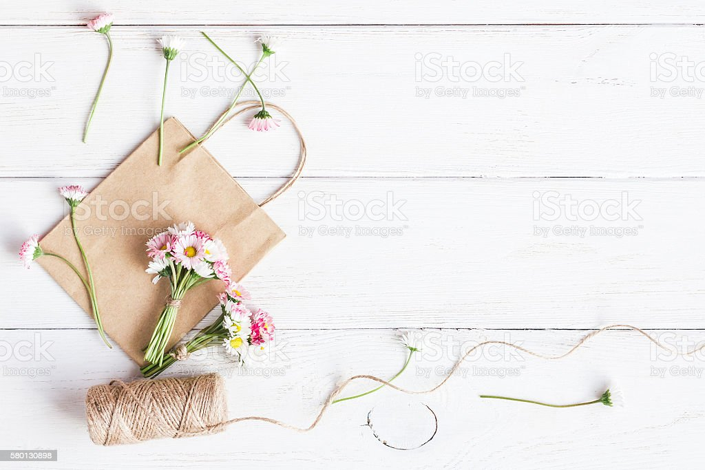 Workspace With Small Bouquets Of Daisy Flowers Paper Bagsflat Lay