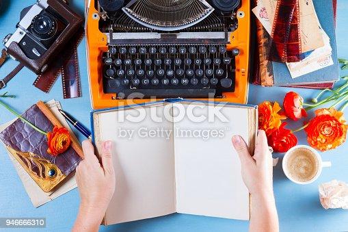 istock Workspace with vintage orange typewriter 946666310