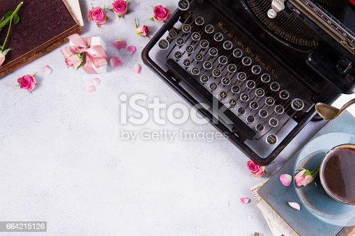 istock Workspace with vintage typewriter 664215126