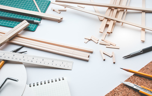 1133176165 istock photo Worktable with balsa wood material.Diy,design project,invention concept 886421524