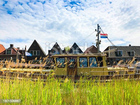 Workum, Friesland, Netherlands: Boat and Row Houses on Canal