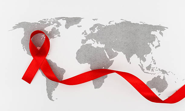 World AIDS Day on world map stock photo