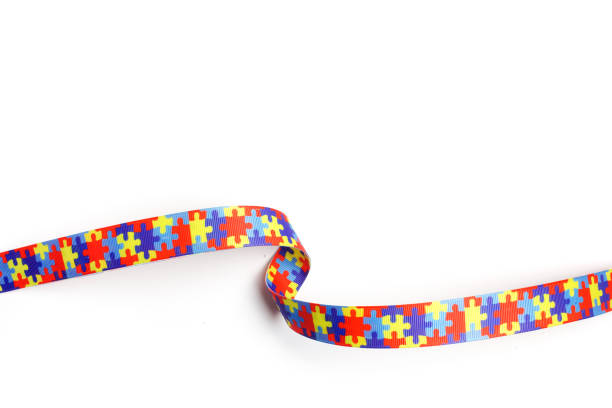World Autism awareness and pride day with Puzzle pattern ribbon isolated on white stock photo