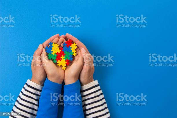 World autism awareness day concept adult and child hands holding on picture id1215019415?b=1&k=6&m=1215019415&s=612x612&h=omobxezpbk g6hvvzq2d0shnd gkdz 1b mszqqwusg=