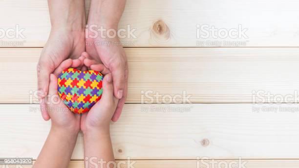 World autism awareness day concept with puzzle or jigsaw pattern on picture id958043920?b=1&k=6&m=958043920&s=612x612&h=bojzc kgknt8lj0qprb823fkc6j55fvu19v18xljlhq=