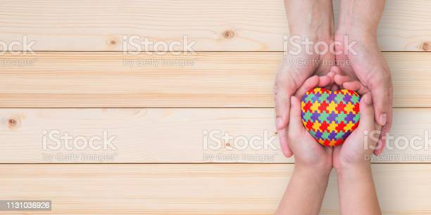 World autism awareness day mental health care concept with puzzle or picture id1131036926?b=1&k=6&m=1131036926&s=612x612&h= cmzf5tazdvbstmyqwwgcwgnzomsp3oju8lgl4g9how=